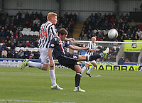 Richard Brittain clears under pressure from Conor Newton in the St Mirren v Ross County Clydesdale Bank Scottish Premier League match played at St Mirren Park, Paisley on 19.1.13.