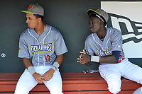 Columbia Fireflies players Mark Vientos (13) and Ronny Mauricio (2) sit in the dugout before a game against the Charleston RiverDogs on Friday, July 12, 2019 at Segra Park in Columbia, South Carolina. The RiverDogs won, 4-3 in 10 innings. (Tom Priddy/Four Seam Images)
