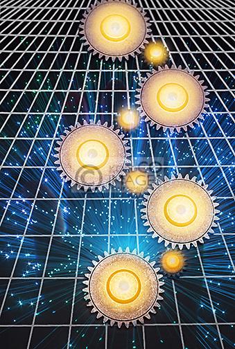 INTERLOCKING COG GEARS ON GRID OVER LIT TIPS OF FIBER OPTIC STRANDS (©KECK MAURER & SCHULTZ / CORNING GLASS WORKS 1970)