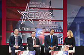 The three Republican appointees to the Federal Communications Commission (FCC) from left to right: Brendan Carr, member, Federal Communications Commission (FCC); Michael O'Rielly, member, FCC; and Ajit Pai, Chairman, FCC; appear on a panel moderated by Michelle Connolly of Duke University, right, at the Conservative Political Action Conference (CPAC) at the Gaylord National Resort and Convention Center in National Harbor, Maryland on Friday, February 23, 2018.<br /> Credit: Ron Sachs / CNP