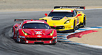 Monterey California, May 4, 2014, Laguna Seca Monterey Grand Prix, the Ferrari of Giancarlo Fisichella being chased by the Corvette of Oliver Gavin.