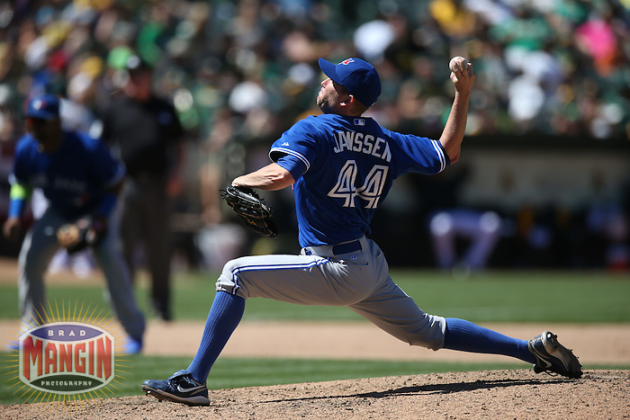 OAKLAND, CA - JULY 6:  Casey Janssen of the Toronto Blue Jays pitches during the game against the Oakland Athletics at O.co Coliseum on Sunday, July 6, 2014 in Oakland, California. Photo by Brad Mangin