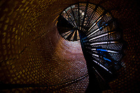 Visitors descend some of the 177 cast iron steps inside the Pensacola Lighthouse.<br /> <br /> COLIN HACKLEY PHOTO