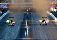 Feb 24, 2018; Chandler, AZ, USA; NHRA top fuel driver Terry McMillen (left) races alongside Antron Brown during qualifying for the Arizona Nationals at Wild Horse Pass Motorsports Park. Mandatory Credit: Mark J. Rebilas-USA TODAY Sports