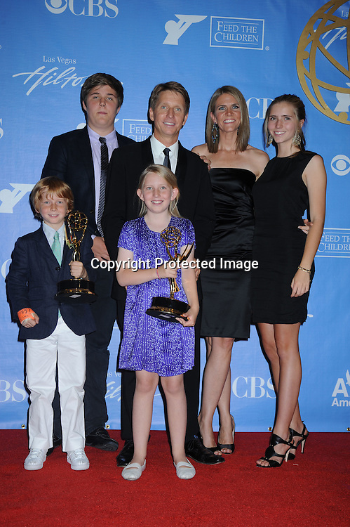 Bradley Bell  and family  posing in the press room from the Daytime Emmy Awards on June 27, 2010 at the Hilton at Las Vegas in Nevada.