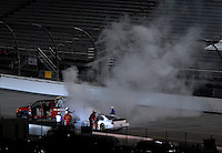 May 4, 2007; Richmond, VA, USA; Safety crews put out a fire on the car of Nascar Busch Series driver Kevin Lepage (53) during the Circuit City 250 at Richmond International Raceway. Mandatory Credit: Mark J. Rebilas
