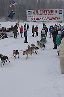 Cassia Condon  leaves the start line of the 2006 Jr. Iditarod race from Willow Lake, Alaska   ..Photo by Ben Schultz