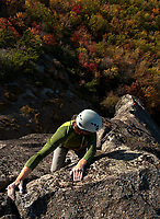 Will Shirey preparing to mantle atop the pedastal that terminates the 2nd pitch of The Great Arete (5.8), Big Lost Cove Cliffs, Pisgah National Forest, North Carolina.