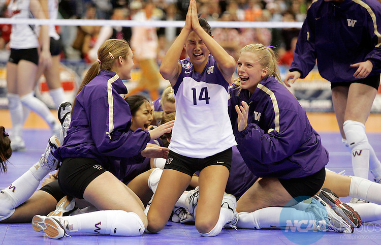 17 DEC 2005:  Candace Lee (14) of the University of Washington celebrates with her teammates after defeating the University of Nebraska during the Division I Women's Volleyball Championship held at the Alamodome in San Antonio, TX.   Washington defeated Nebraska 3-0 to win the national title.  Jamie Schwaberow/NCAA Photos