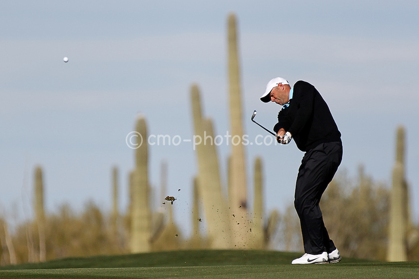 Feb 24, 2008; Marana, AZ, USA; Stewart Cink hits an approach shot towards the 11th green during his final-round match against Tiger Woods (not pictured) at the Accenture Match Play Championship at the Gallery Golf Club.