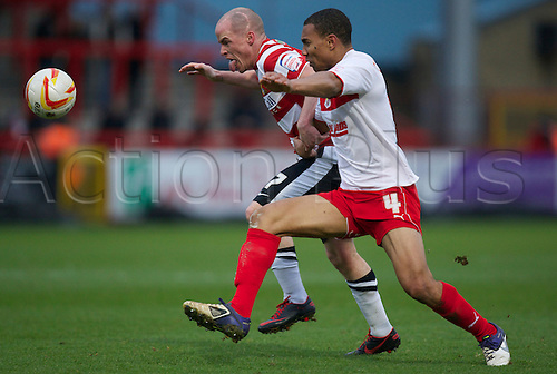 12.01.2013 Stevenage, England.  Ian Hume and Darius Charles  in action during the League One game between Stevenage and Doncaster Rovers at Broadhall Way.