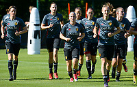 20170717 - RIJEN , NETHERLANDS :  illustration picture shows the Belgian team with Aline Zeler, Heleen Jaques, Jana Coryn , YAna Daniels (r) during warming up of a training session of the Belgian national women's soccer team Red Flames on the pitch of Rijen , on Tuesday 18 July 2017 in Rijen . The Red Flames are at the Women's European Championship 2017 in the Netherlands. PHOTO SPORTPIX.BE | DAVID CATRY