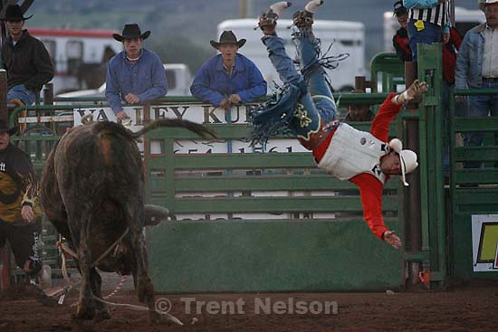 Heber City - Caleb Bennett flies off the bull Shock and Awe at the Utah High School Rodeo.