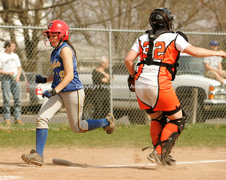 WATERTOWN, CT 4/23/07- 042307BZ13- Seymour's Katie Barsevich (19) crosses the plate as Watertown's Alysa Caouette (32) waits for the ball.<br /> Jamison C. Bazinet Republican-American