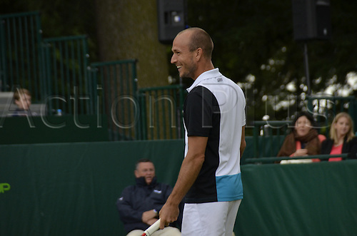 22.06.2013. Stoke park, Slouogh, berkshire, England. The Boodles Challenge mens doubles finals. Jamie Delgado of Great Britain and his American partner James Cerrentani versus the pairing of Adil Shamasolin and Rameez Junaid. Cerrentani sees the funny side of the action