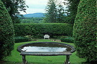 Framing a view: Naumkeag, designed by Fletcher Steel for Mabel Choate. Reflecting pool with bench, overlooking Berkshire Mountains. Sculpture and form in design of a garden.