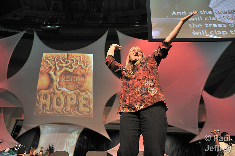 Marcia McFee, the director of worship for the 2008 United Methodist General Conference in Fort Worth, Texas, leads singing during the April 27 session.