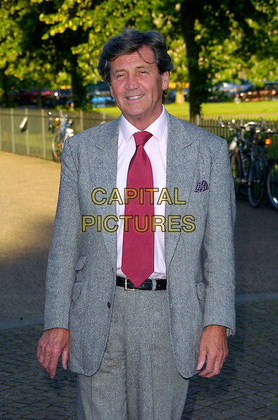 "MELVYN BRAGG.Attends journalist and former Vanity Fair editor Tina Brown's Book Launch Party for ""The Diana Chronicles"", a biography of The Princess Of Wales, held at The Serpentine Gallery,.London, England, June 18th 2007..half length red tie grey suit.CAP/CAN.©Can Nguyen/Capital Pictures"