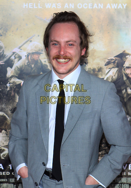 "TOM BUDGE .Attending the Los Angeles Premiere of HBO's ""The Pacific"" held at Grauman's Chinese Theater, Hollywood, California, USA, 24th February 2010 .half length moustache mustache grey gray suit tie black white shirt smiling facial hair .CAP/ADM/TC.©T. Conrad/AdMedia/Capital Pictures."