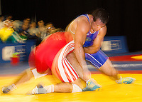 17 JUL 2010 - SHEFFIELD, GBR - Yury Beldnovskiy (RUS)(blue) attempts to overpower Ivan Yankouski (BLR)(red) on his way to victory in the mens 96kg final at the GB Cup (PHOTO (C) NIGEL FARROW)