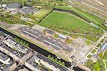 Nederland, Noord-Holland, Amsterdam, 09-04-2014;<br /> Detail Cultuurpark Westergasfabriek en Westerpark op het voormalige  Westergasterrein, langs de Haarlemmertrekvaart en de Haarlemmerweg. Links van het kanaal woonwijk de multiculturele Staatsliedenbuurt. <br /> Culture park Westergasfabriek and the Westerpark on the former Westergasterrein (gasworks), and residential district on the other side of the channel.<br /> luchtfoto (toeslag op standard tarieven);<br /> aerial photo (additional fee required);<br /> copyright foto/photo Siebe Swart