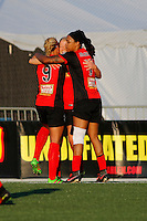 Rochester, NY - Friday June 24, 2016: Western New York Flash midfielder Makenzy Doniak (3), forward Lynn Williams (9), forward Jessica McDonald (14) celebrate during a regular season National Women's Soccer League (NWSL) match between the Western New York Flash and the Boston Breakers at Rochester Rhinos Stadium.