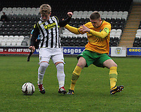 Jon Scullion shielding the ball from Marcus Fraser in the St Mirren v Celtic Scottish Professional Football League Under 20 match played at St Mirren Park, Paisley on 30.4.14.