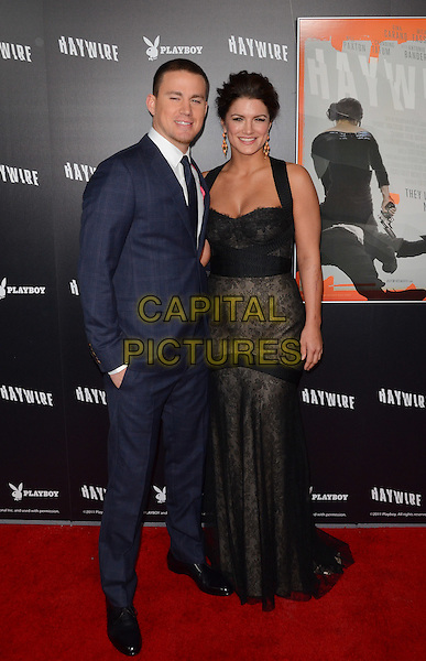 Channing Tatum, Gina Carano.The L.A. Premiere of 'Haywire' held at The DGA in West Hollywood, California, USA..January 5th, 2012.full length white shirt tie blue suit black dress lace hand in pocket .CAP/ADM/TW.©Tonya Wise/AdMedia/Capital Pictures.