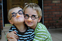 Brothers hamming it up in Grouch Marx glasses