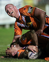 Picture by Alex Whitehead/SWpix.com - 06/03/2015 - Rugby League - First Utility Super League - Castleford Tigers v Wigan Warriors - the Mend A Hose Jungle, Castleford, England - Castleford's Michael Shenton (below) is congratulated on his try by Steve Crossley (above).
