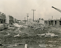 1941  March  06..Merrimack Landing   ..Merrimack Park.Project VA-6-1 Looking North, service drive between Bldgs E-5 & E-6.#23..NEG#.3510..