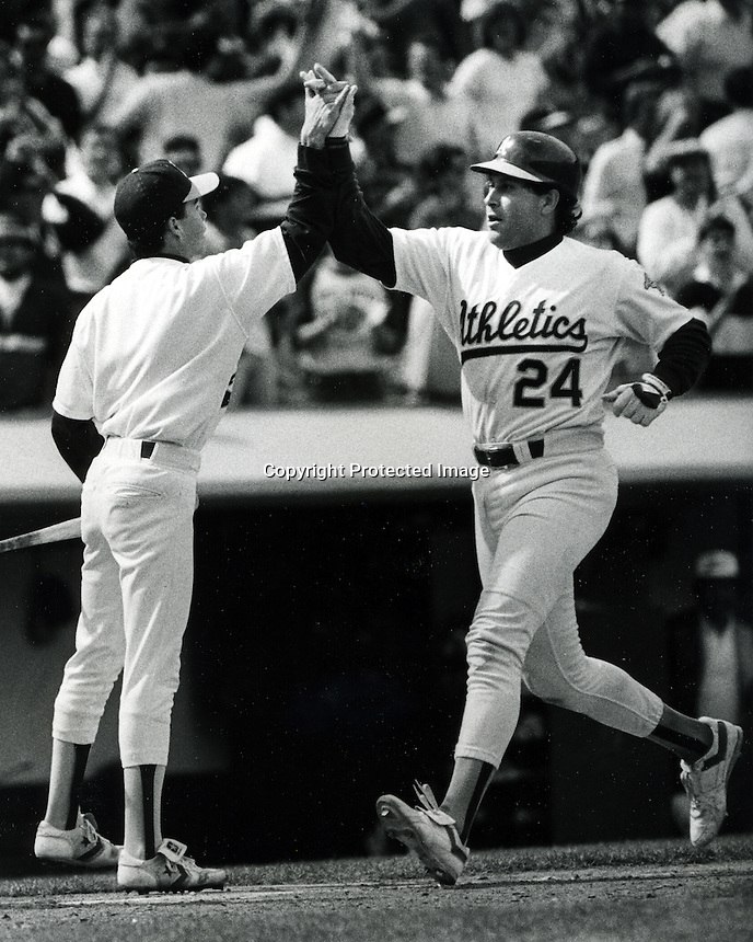 Oakland Athletics Ron Hassey home run. <br />(1988 photo by Ron Riesterer/photoshelter)