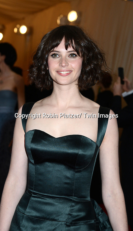 Felicity Jones attends the Costume Institute Benefit on May 5, 2014 at the Metropolitan Museum of Art in New York City, NY, USA. The gala celebrated the opening of Charles James: Beyond Fashion and the new Anna Wintour Costume Center.