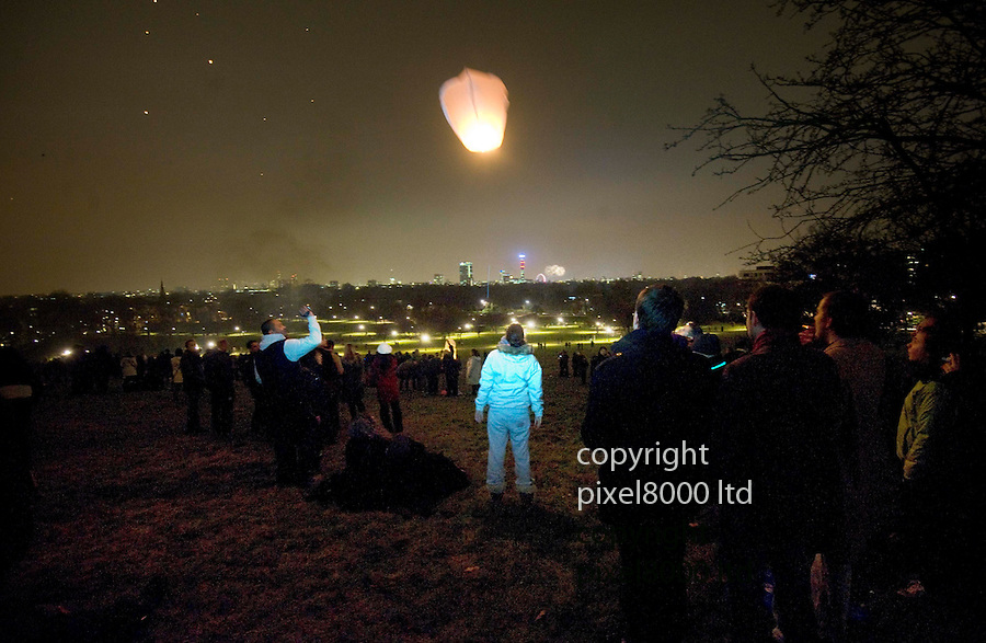 New Year 2011.Seen from Primrose Hill in North London.Fireworks going off at Millennium wheel and Chinese lanterns set off by revellers....Picture by Gavin Rodgers/ Pixel 8000 ..07917221968