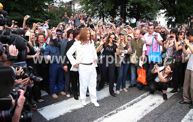 **ALL ROUND PICTURES FROM SOLARPIX.COM**.**WORLDWIDE SYNDICATION RIGHTS**.Fans to gather at the legendary zebra crossing, to recreate the Beatles' iconic Abbey Road album cover, celebrating 40 years since its release. St Johns Wood, London. 8 August 2009..This pic: Abbey Road..JOB REF: 9724 LNJ     DATE: 08_08_2009.**MUST CREDIT SOLARPIX.COM OR DOUBLE FEE WILL BE CHARGED**.**MUST NOTIFY SOLARPIX OF ONLINE USAGE**.**CALL US ON: +34 952 811 768 or LOW RATE FROM UK 0844 617 7637**