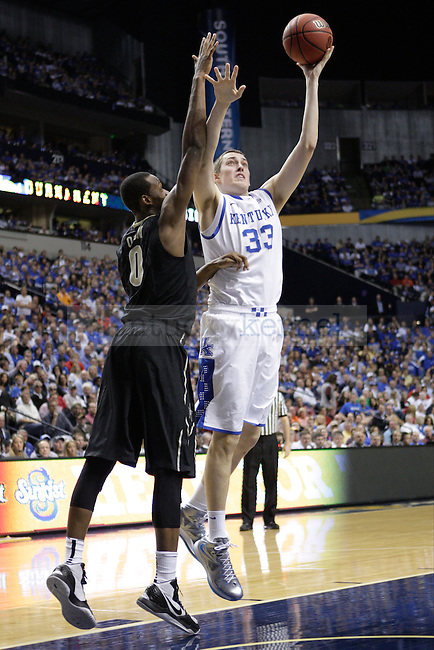 Kentucky forward Kyle Wiltjer jumps to shoot the ball against Vanderbilt forward Rod Odom during the second half of the University of Kentucky men's basketball game vs. Vanderbilt University during the SEC Tournament at Bridgestone Arena in Nashville, Tenn., on Friday, March 15, 2013. UK lost 64-48. Photo by Tessa Lighty | Staff