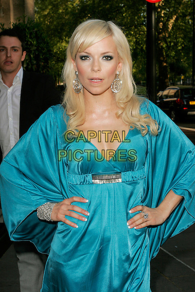 SEPTEMBER (Petra Eos Marklund).The Sony Radio Academy Awards 2009, Grosvenor House Hotel, Park Lane, London, England..May 11th, 2009.half length blue silk satin dress sleeves silver bracelet artist hands on hips cleavage dangling earrings .CAP/AH.©Adam Houghton/Capital Pictures.