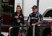 May 3, 2013; Commerce, GA, USA: NHRA top fuel dragster driver Leah Pruett (left) with crew member waiting out the rain during qualifying for the Southern Nationals at Atlanta Dragway. Mandatory Credit: Mark J. Rebilas-