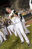 Jacksonville Suns pinch hitter Danny Black (38) celebrates after game three of the Southern League Championship Series against the Chattanooga Lookouts on September 12, 2014 at Bragan Field in Jacksonville, Florida.  Jacksonville defeated Chattanooga 6-1 to sweep three games to none.  (Mike Janes/Four Seam Images)