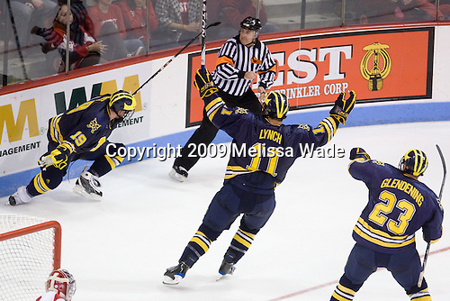 Matt Rust (Michigan - 19), Kevin Lynch (Michigan - 11), Luke Glendening (Michigan - 23) - The Boston University Terriers defeated the University of Michigan Wolverines 3-2 on Saturday, October 24, 2009, at Agganis Arena in Boston, Massachusetts.