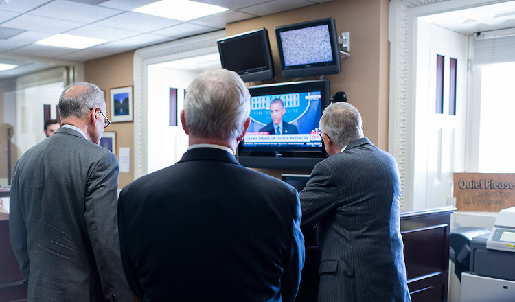 UNITED STATES - JUNE 18: From left, Sen. Chuck Schumer, D-N.Y., Senate Minority Whip Dick Durbin, D-Ill., and Senate Minority Leader Harry Reid, D-Nev., watch President Barack Obama speak about the shooting in Charleston before holding their news conference in the Senate Radio/TV Gallery on budget negotiations on Thursday, June 18, 2015. (Photo By Bill Clark/CQ Roll Call)