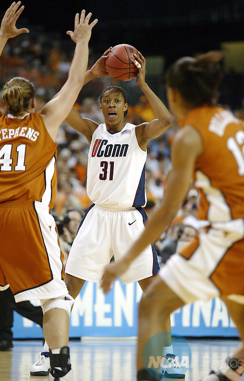 6 APR 2003:  Center Jessica Moore (31) of the University of Connecticut looks for an open teammate against center Stacy Stephens (41) of the University of Texas during the Division 1 Women's Semifinal Basketball Game held at the Georgia Dome in Atlanta, GA. Connecticut defeated Texas71-69 to advance to the national title game.  Jamie Schwaberow/NCAA Photos