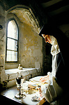 Catholic Nun a member of the Sister of the Precious Blood Hertfordshire England. Cleaning church convent silver. Closed order.
