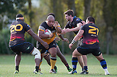 Owen Paletua goes for the gap between Iliesa Kali, Zac Wootten and Robert Katu. Counties Manukau Premier Club rugby game between Te Kauwhata and Onewhero, played at Te Kauwhata on Saturday April 16th 2016. Onewhero won the game 37 - 0 after leading 13 - 0 at Halftime. Photo by Richard Spranger.
