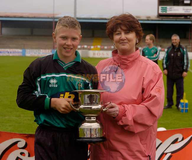 30-04-06 Drogheda Concentrates Drogheda and District Schoolboys/Girls League held in O2 park, Drogheda..Albion's captain Conor Grimes receives the winning trophy from Margaret Harty (Sponsor, Drogheda Concentrates) after Albion won the U11 Cup final against Duleek..Photo:Barry Cronin/www.newsfile.ie