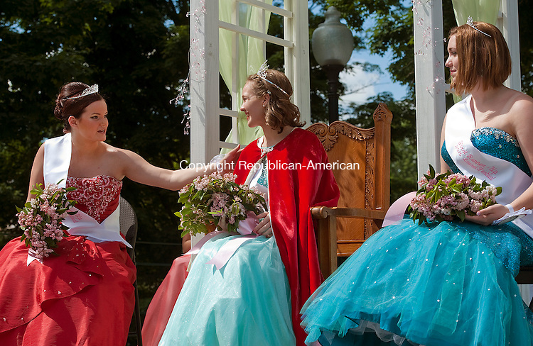 WINSTED, CT--061315JS09-   2015 Laurel Queen Olivia Ortman, center, receives congratulations from second runner-up Abigail Rodriguez, left, as first runner-up Molly Robitaille, right, looks on during the 2015 Laurel Festival Parade and ceremonies at East End Park in Winsted on Saturday.<br /> Jim Shannon Republican-American