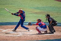 Guillermo Aviles (21) en su turno al bat  en el sexto inning por los  Alazanes de Gamma de Cuba, durante el partido de beisbol de la Serie del Caribe contra los Criollos de Caguas de Puerto Rico en estadio de los Charros de Jalisco en Guadalajara, México, Martes 6 feb 2018.  (Foto: AP/Luis Gutierrez)