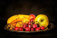 Bananas,Peaches,Cherries and an apple lying on a silver plate. Photographed on dark background, and developed in different graphic programs to give it a painterly look.
