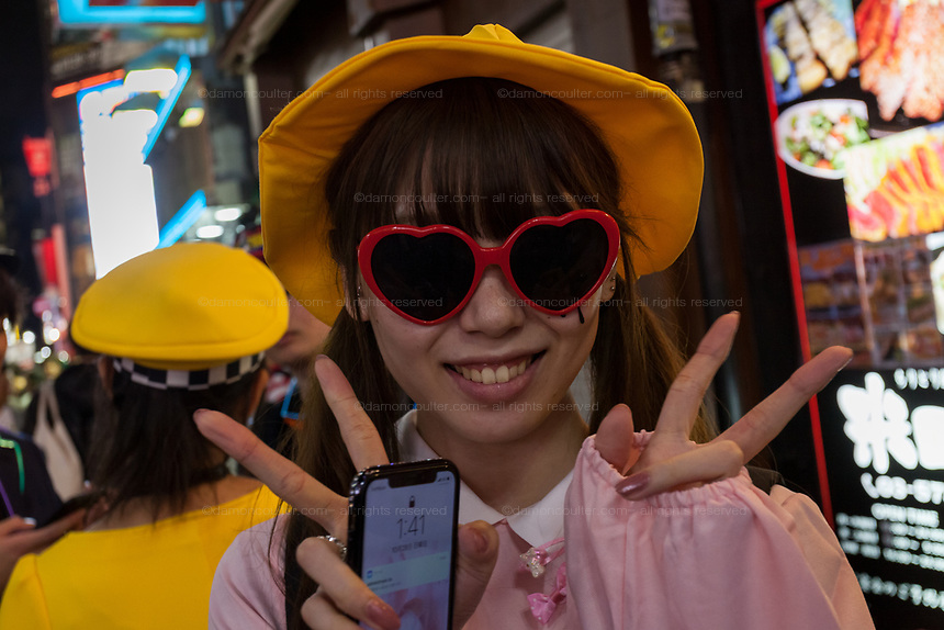 A Japanese woman dressed as an  elementary school student during the Halloween celebrations Shibuya, Tokyo, Japan. Saturday October 27th 2018. The celebrations marking this event have grown in popularity in Japan recently. Enjoyed mostly by young adults who like to dress up, drink , dance and misbehave in parts of Tokyo like Shibuya and Roppongi. There has been a push back from Japanese society and the police to try to limit the bad behaviour.