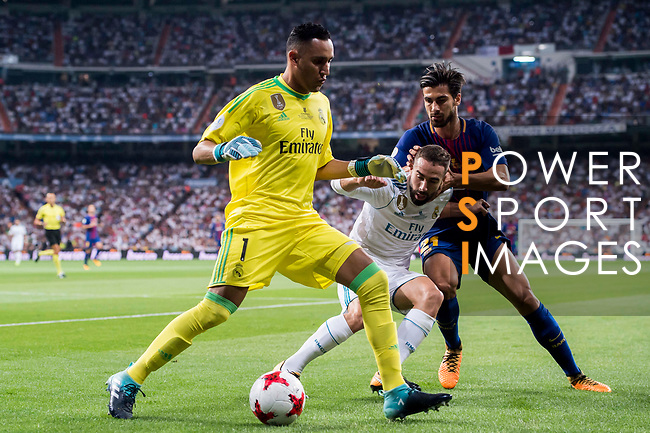 Goalkeeper Keylor Navas (l) of Real Madrid in action as Daniel Carvajal Ramos (c) of Real Madrid fights for the ball with Andre Filipe Tavares Gomes of FC Barcelona during their Supercopa de Espana Final 2nd Leg match between Real Madrid and FC Barcelona at the Estadio Santiago Bernabeu on 16 August 2017 in Madrid, Spain. Photo by Diego Gonzalez Souto / Power Sport Images
